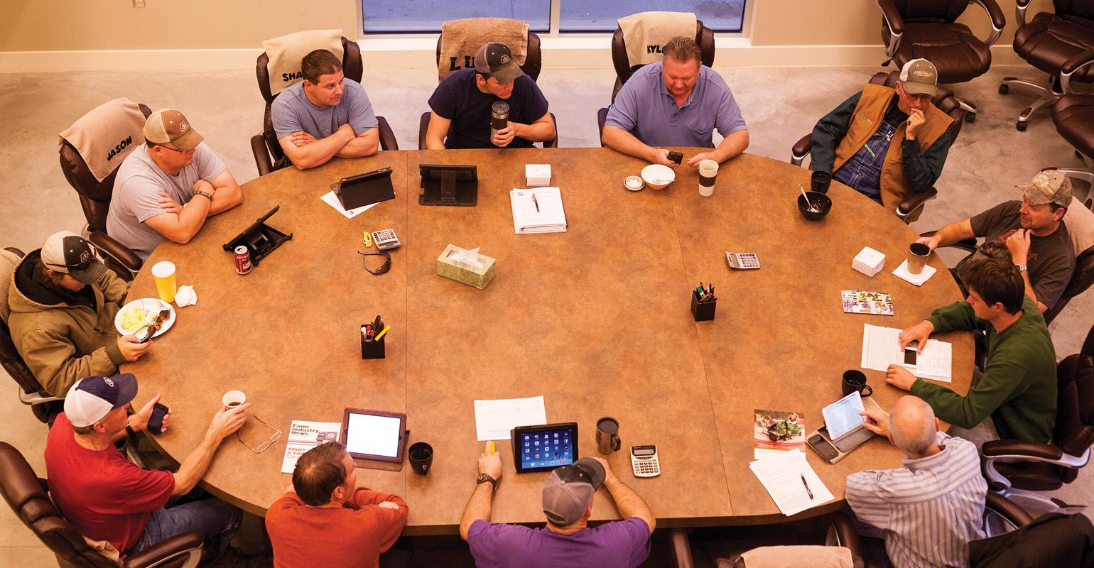 Group of guys meeting around large conference table